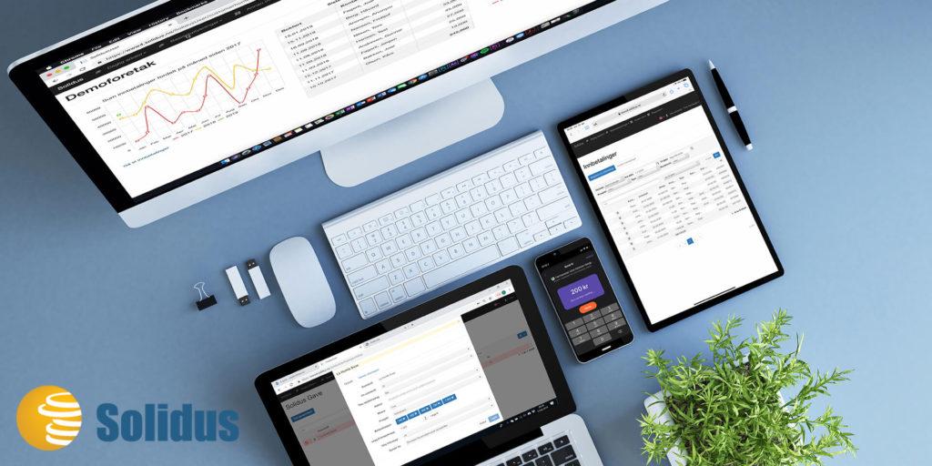 Bilde av en pc, tastatur, ipad og mobil. Bildet skal illustrere en arbeidsdag til en ansatt på kontor.